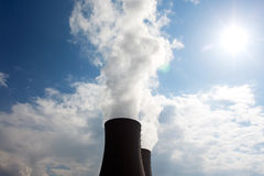 Nuclear power plant against sky and sun Stock Image