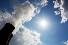 Nuclear power plant against the sky and sun Royalty Free Stock Photo
