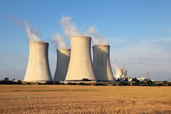Nuclear power plant and agriculture field Stock Images