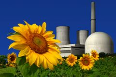 Nuclear power plant behind a sunflower field Stock Images