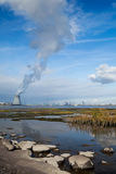 Nuclear power plant blue sky clouds harbor Stock Photo