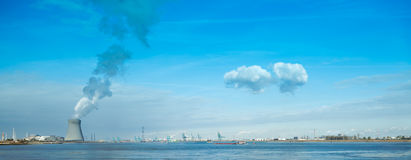 Nuclear power plant blue sky clouds harbor Stock Photos