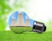 Nuclear power plant in bulb. Energy concept Royalty Free Stock Images