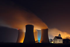 Nuclear power plant and a chapel Royalty Free Stock Photo