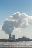 Nuclear power Plant. Clouds of thick smoke on blue sky background. Copy space. Vertical image Royalty Free Stock Photography