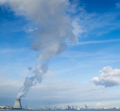 Nuclear power plant CO2 neutral harbor sky. Cooling towers of a nuclear power plant creating clouds in blue sky at Antwerp harbor electricity generation for Stock Photo