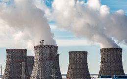 Nuclear Power Plant with Cooling Towers and Huge White Vapor. Or Smoke Stock Photo