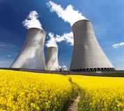 Nuclear power plant Dukovany with golden flowering field Stock Images