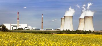 Nuclear power plant Dukovany with golden glowering field. Of rapeseed - Czech Republic - two possibility for production energy Stock Photo