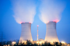 Nuclear power plant at dusk Stock Images