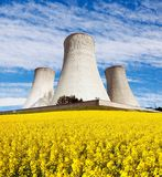 Nuclear power plant with field of rapeseed. Nuclear power plant Dukovany with golden glowering field of rapeseed - Czech Republic - two possibility for Stock Image