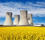 Nuclear power plant with field of rapeseed. Nuclear power plant Dukovany with golden glowering field of rapeseed - Czech Republic - two possibility for Royalty Free Stock Photography