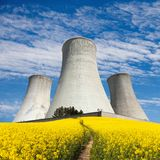 Nuclear power plant and field of rapeseed Stock Photos