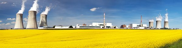 Nuclear power plant with field of rapeseed. Nuclear power plant Dukovany with golden glowering field of rapeseed - Czech Republic - two possibility for Royalty Free Stock Image