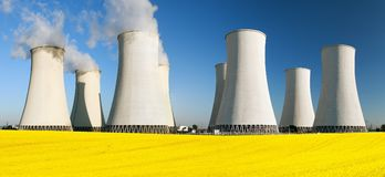 Nuclear power plant with field of rapeseed Royalty Free Stock Image