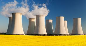 Nuclear power plant with field of rapeseed Stock Photo
