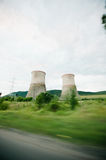 Nuclear power plant in a green environment. Stock Images
