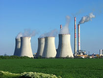 Nuclear power plant in green field Royalty Free Stock Image