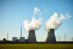 Nuclear power plant. The nuclear power plant Gundremmingen (Germany) with its cooling towers emitting water vapor stock photo