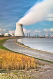 Nuclear power plant in harbor chimney smoke Stock Photos