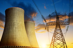 Nuclear power plant with high voltage tower. At sunset Royalty Free Stock Photos