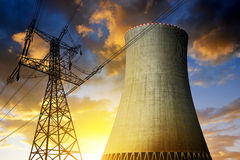 Nuclear power plant with high voltage towers. Against the sunset Stock Photography