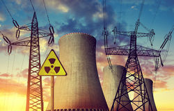 Nuclear power plant with high voltage towers. Against the sunset Royalty Free Stock Image