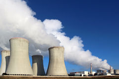 Nuclear power plant and huge smoke from cooling towers stock photography