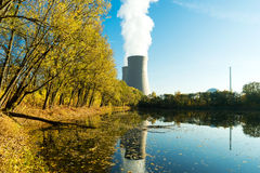 Nuclear power plant next the pond and its reflection Stock Photos