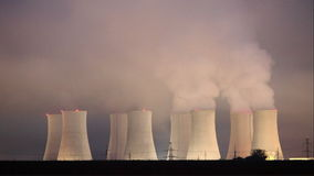 Nuclear power plant by night - Time lapse stock footage