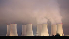 Nuclear power plant by night - Time lapse stock video footage