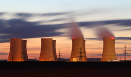 Nuclear power plant orange clouds at night Stock Image