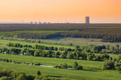 Nuclear power plant pollution green field Royalty Free Stock Image