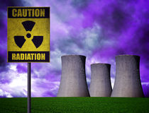Nuclear power plant with radioactivity warning symbol. In dramatic cloudy sky Royalty Free Stock Photos