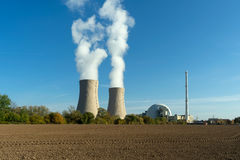 Nuclear power plant on sky background in sunlight Stock Images