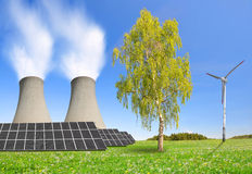 Nuclear power plant solar panel and wind turbines. Royalty Free Stock Images