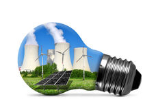 Nuclear power plant with solar panel and wind turbines in lightbulb Stock Images