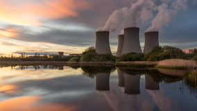 Nuclear power plant. By sunset in the landscape with small lake. Timelapse video