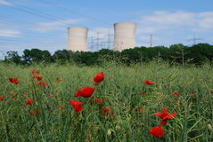 Nuclear power plant. Under blue heaven and corn poppys in front stock photography