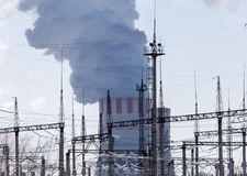 Nuclear power plant with white smoke or vapour from cooling tower Stock Image