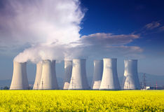 Nuclear power plant with yellow field Royalty Free Stock Photography