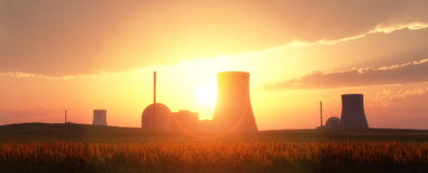 Nuclear power plants. In a wheat field and sunset Stock Images