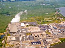 Nuclear power station. An aerial view of the cooling tower and rising steam from a nuclear power plant Stock Photo