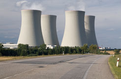 Nuclear power station. Temelin, Czech Republic - cooling towers, containment buildings, stubble-field in foreground Royalty Free Stock Image