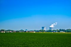 Nuclear power station in the city. A nuclear power plant located in the countryside close to homes Stock Image