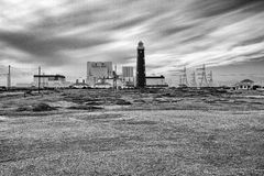 Nuclear Power Station at Dungeness. Dungeness Power Station and lighthouse as the cloud moves in Stock Photo