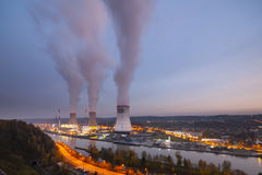 Nuclear Power Station At Dusk. A large nuclear power station by a river at dusk Royalty Free Stock Photo