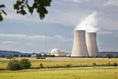 Nuclear Power Plant In River Landscape. A nuclear power station in green river landscape Royalty Free Stock Photography