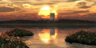 Nuclear power. Station on an island and sunset Royalty Free Stock Photo