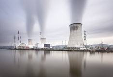 Nuclear Power Station Long Exposure. Long exposure shot of a large nuclear power station by a river on a gray day Royalty Free Stock Images